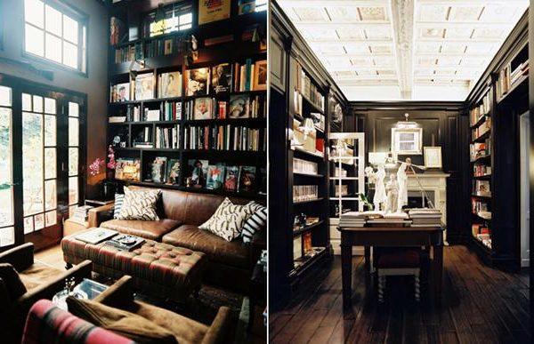 Preto nas paredes da biblioteca contrastam com o branco da lareira e portas. Sofá e poltronas camelo, mesma tonalidade do piso e mesa de madeira.
