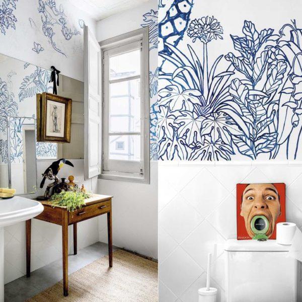 Meia parede em azulejos brancos muito simples e pintura, assinada por Mario Antón, fazem par para lá de bacana